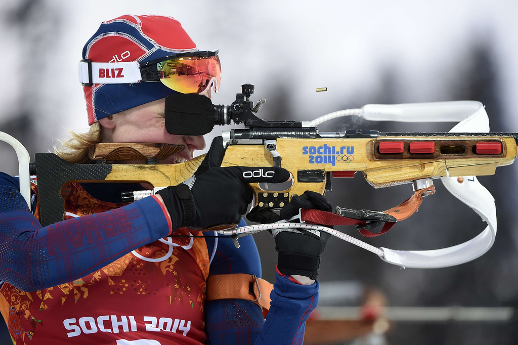. Norway\'s Tora Berger competes at the shooting range to win gold in the Biathlon mixed 2x6 km + 2x7,5 km Relay at the Laura Cross-Country Ski and Biathlon Center during the Sochi Winter Olympics on February 19, 2014 in Rosa Khutor near Sochi. AFP PHOTO / ODD ANDERSEN/AFP/Getty Images