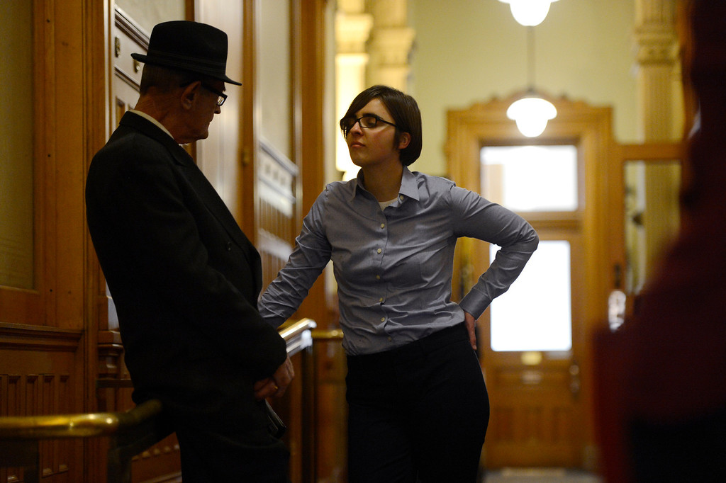 . Denver, CO. - January 23: Dennis Dougherty 69 and Courtney Law 30 talk in the hallway as the Senate Judiciary Committee listens to testimony on Senate Bill 11 at the Denver State Capitol. The gay bikers, as Dennis referred to them because they ride their Harley\'s together, are in favor of the bill would allow gay couples to form civil unions. Law and her partner have been together for 7 years.  Denver, Colorado January 23, 2013. (Photo By Joe Amon / The Denver Post)