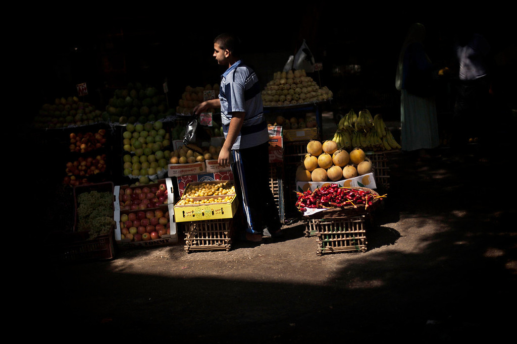 . A fruit vendor waits for customers at Suleiman Gohar market in Dokki district in Cairo, Egypt, Monday, Aug. 26, 2013. Egypt\'s recent turmoil has scared away tourists and�affected the livelihood of the�one in eight Egyptians who earn their living�from tourism. An evening curfew imposed by the military to quell protests has�further choked many businesses,�such as�restaurants, stores and entertainment venues,�serving another blow to the country\'s already battered economy. (AP Photo/Manu Brabo)