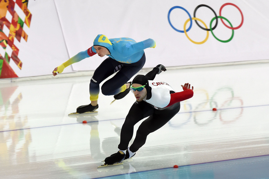 . Kazakhstan\'s Roman Krech (back) and Canada\'s William Dutton compete in the Men\'s Speed Skating 1000 m at the Adler Arena during the Sochi Winter Olympics on February 12, 2014.  DAMIEN MEYER/AFP/Getty Images