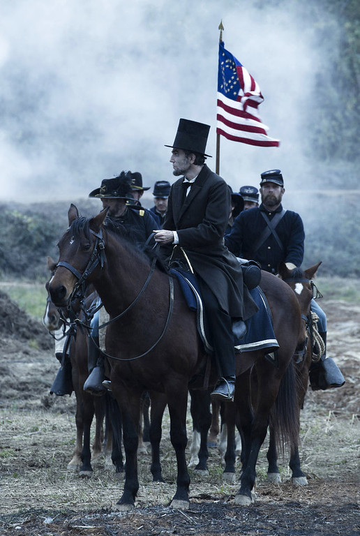 ". This undated publicity photo provided by DreamWorks and Twentieth Century Fox shows Daniel Day-Lewis as President Abraham Lincoln looking across a battlefield in the aftermath of a terrible siege in this scene from director Steven Spielberg\'s drama ""Lincoln.\"" (AP Photo/DreamWorks, Twentieth Century Fox, David James)"