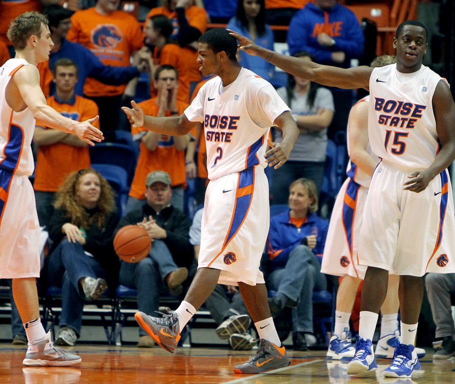 . Boise State\'s Derrick Marks, center, celebrates with Anthony Drmic, left, and Thomas Bropleh after blocking a shot by Air Force during the second half of their NCAA college basketball game, Wednesday, Feb. 20, 2013, in Boise, Idaho. Boise State won 77-65. (AP Photo/The Idaho Statesman, Joe Jaszewski)  LOCAL TV OUT