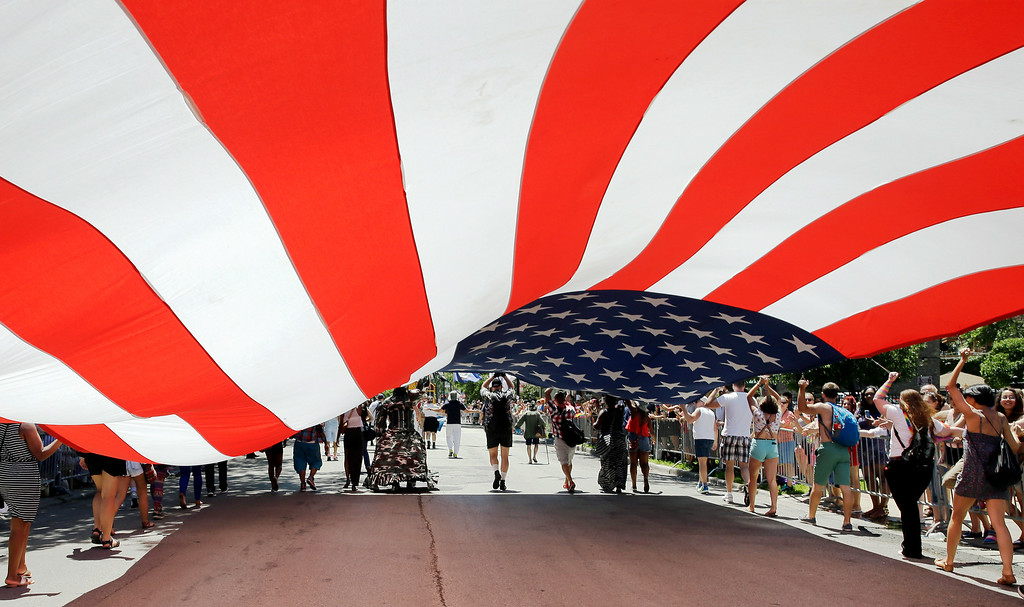 . Members of the Gay, Lesbian and Bisexual Veterans Association march with a big U.S. Flag at the 45th Annual Chicago Pride Parade during the parade on Broadway Street in Chicago, Sunday, June 29, 2014. (AP Photo/Nam Y. Huh)