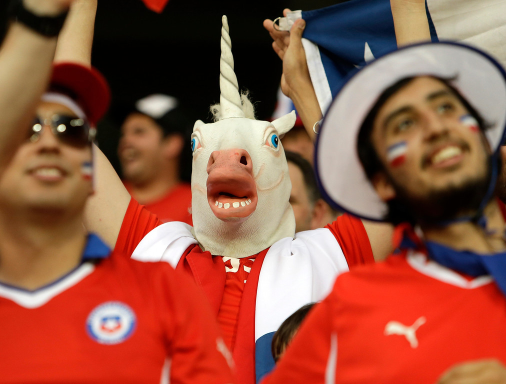 . Fans of Chile cheer for their team before the group B World Cup soccer match between Chile and Australia in the Arena Pantanal in Cuiaba, Brazil, Friday, June 13, 2014. (AP Photo/Thanassis Stavrakis)