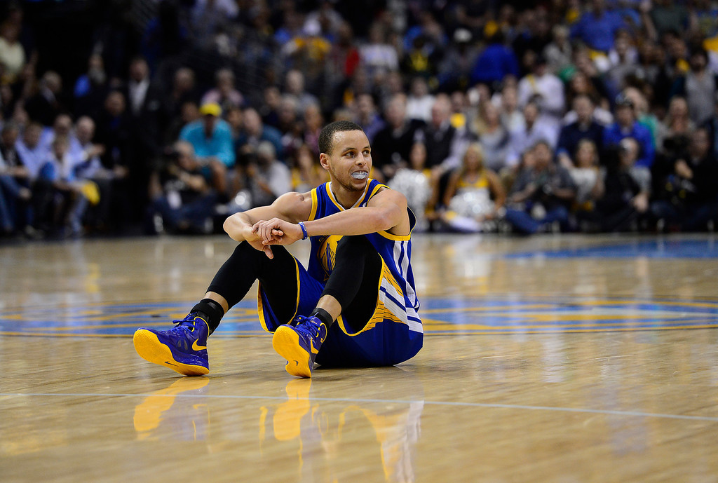 . Golden State Warriors point guard Stephen Curry (30) takes a breather in the second quarter. The Denver Nuggets took on the Golden State Warriors in Game 5 of the Western Conference First Round Series at the Pepsi Center in Denver, Colo. on April 30, 2013. (Photo by AAron Ontiveroz/The Denver Post)