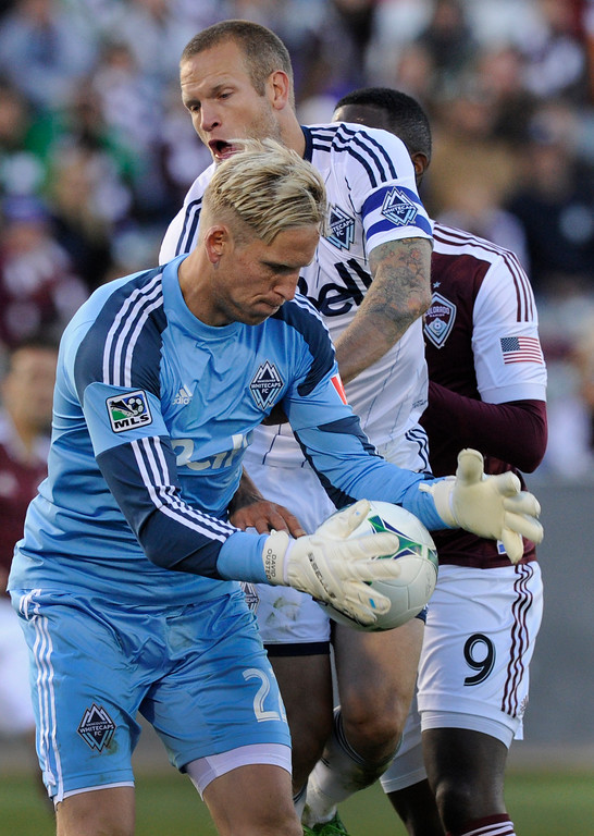 . COMMERCE CITY, CO. - OCTOBER 19: Vancouver goalkeeper David Ousted cut in front of defender Jay DeMerit (6) to keep the ball away from Colorado forward Edson Buddle (9) in the second half. The Colorado Rapids defeated the Vancouver Whitecaps 3-2 at Dick\'s Sporting Goods Park Saturday, October 19, 2013. Photo By Karl Gehring/The Denver Post
