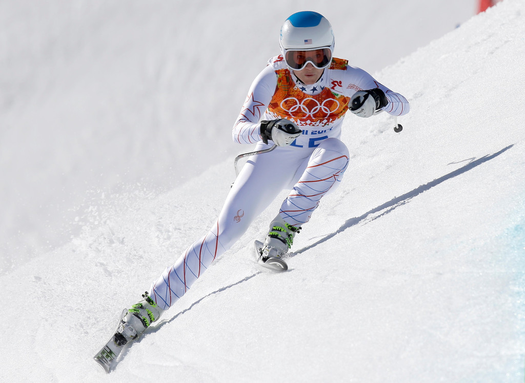 . United States\' Julia Mancuso makes a turn during the women\'s downhill at the Sochi 2014 Winter Olympics, Wednesday, Feb. 12, 2014, in Krasnaya Polyana, Russia.(AP Photo/Luca Bruno)