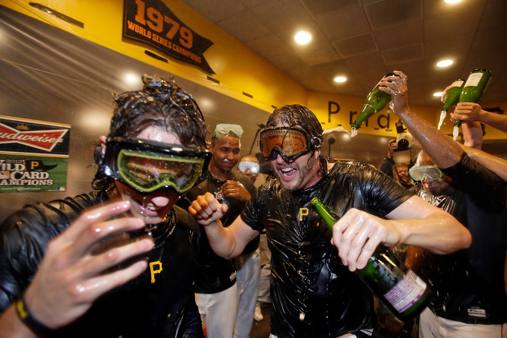 . Pittsburgh Pirates\' Jason Grilli, center, celebrates with Jeff Locke, left, after the Pirates defeated the Cincinnati Reds 6-2 in the NL wild-card playoff baseball game in Pittsburgh on Tuesday, Oct. 1, 2013. The Pirates advanced to the NL division series against the St. Louis Cardinals. (AP Photo/Gene J. Puskar)