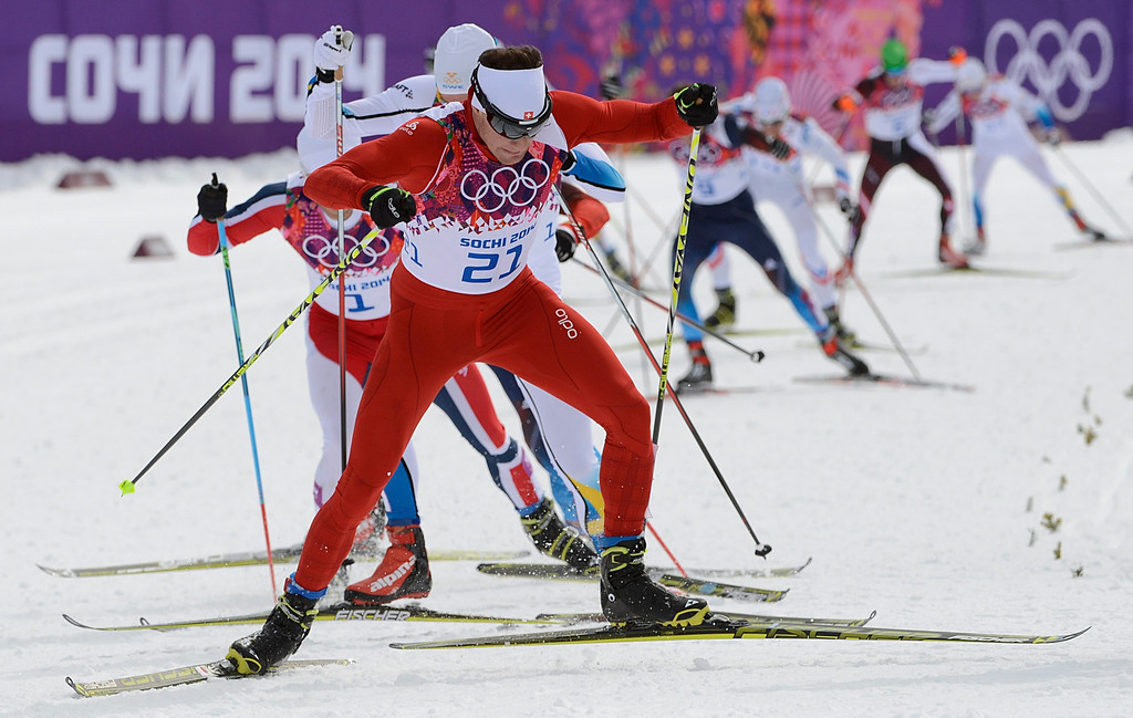 . Dario Cologna of Switzerland leads the pack during the men\'s 15km + 15km Skiathlon competition in the Laura Cross Country Center at the Sochi 2014 Olympic Games, Krasnaya Polyana, Russia, 09 February 2014.  EPA/FILIP SINGER
