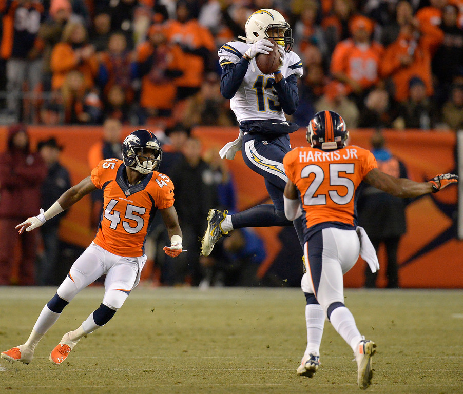 . DENVER, CO - DECEMBER 12: San Diego Chargers wide receiver Keenan Allen (13) makes a catch between Denver Broncos cornerback Dominique Rodgers-Cromartie (45) and cornerback Chris Harris (25) during the second quarter. The Denver Broncos vs. the San Diego Chargers at Sports Authority Field at Mile High in Denver on December 12, 2013. (Photo by John Leyba/The Denver Post)