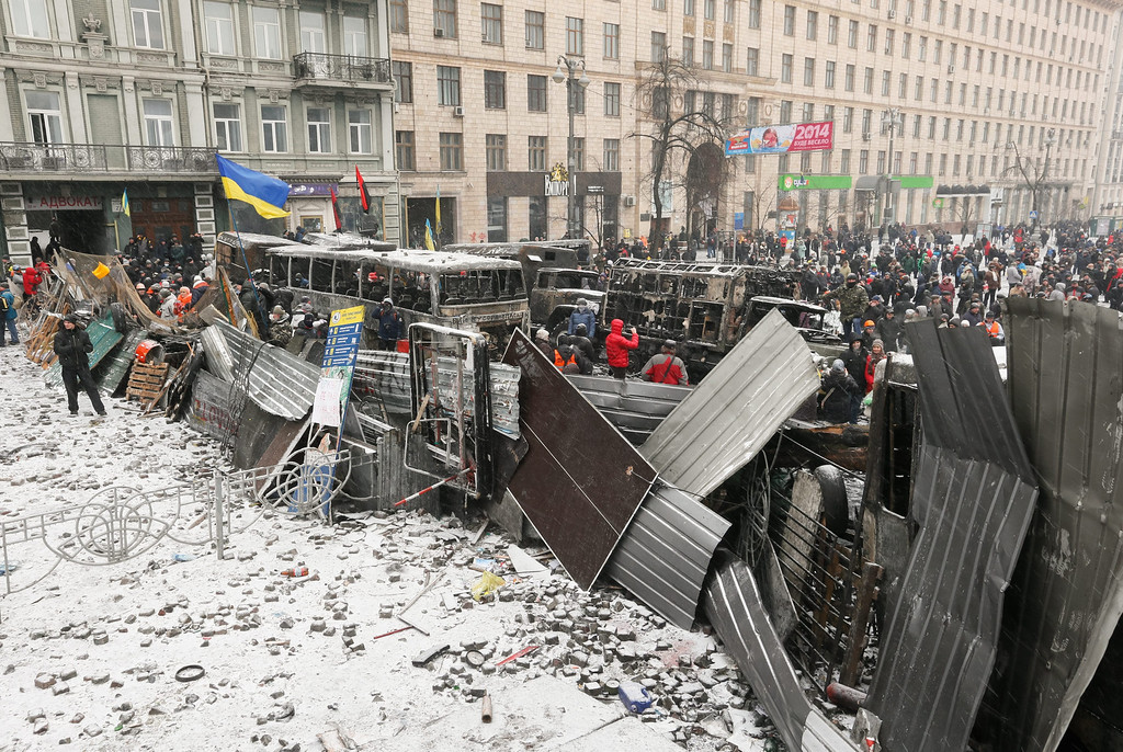 . Ukrainian\'s stand on a barricade during an anti-government protest in downtown Kiev, Ukraine, 21 January 2014.  EPA/SERGEY DOLZHENKO