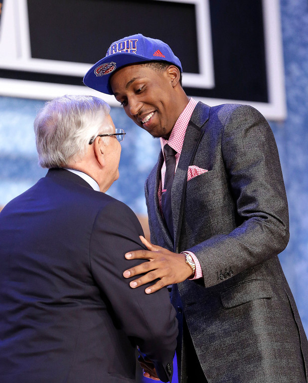 . NBA Commissioner David Stern, left, shakes hands with Georgia\'s Kentavious Caldwell-Pope, who was selected by the Detroit Pistons in the first round of the NBA basketball draft, Thursday, June 27, 2013, in New York. (AP Photo/Kathy Willens)