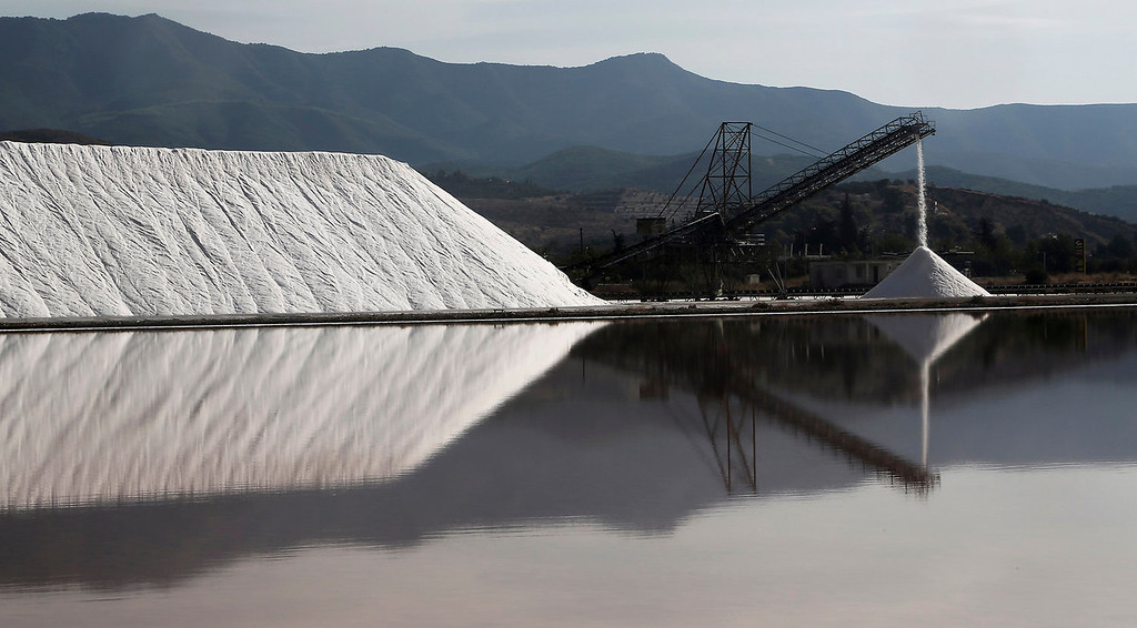 . Piles of salt are stored at a production site in Messolongi, western Greece on Monday Sept. 30, 2013. Salt lakes at Messolongi are used for production by solar evaporation. The facilities are the largest saltworks in Greece, and are located at a protected wetland complex of estuaries and lagoons. (AP Photo/Dimitri Messinis)