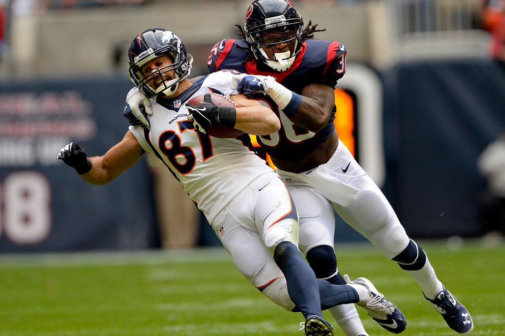 . HOUSTON, TX. - December 22: Wide receiver Eric Decker #87 of the Denver Broncos picks up a first down in front of strong safety D.J. Swearinger #36 of the Houston Texans in the first quarter at Reliant Stadium December 22, 2013 Houston, Texas. (Photo By Joe Amon/The Denver Post)