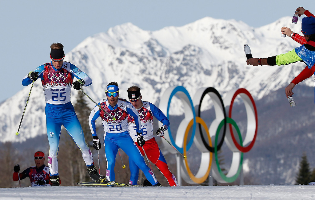 . Lari Lehtonen of Finland, Roland Clara of Italy and Lukas Bauer of the Czech Republic compete in the Men\'s 50km Mass Start Free Cross Country Skiing event in the Laura Cross-Country Ski & Biathlon Center during the Sochi 2014 Olympic Games.  EPA/VALDRIN XHEMAJ