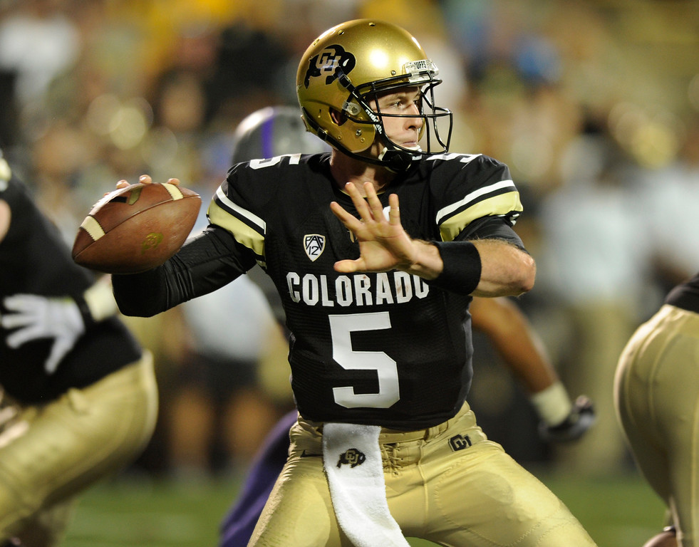 . BOULDER, CO. - SEPTEMBER 76: Buffs quarterback Connor Wood fired up the middle in the second half. The University of Colorado football team hosted Central Arkansas at Folsom Field Saturday night, September 7, 2013. Photo By Karl Gehring/The Denver Post