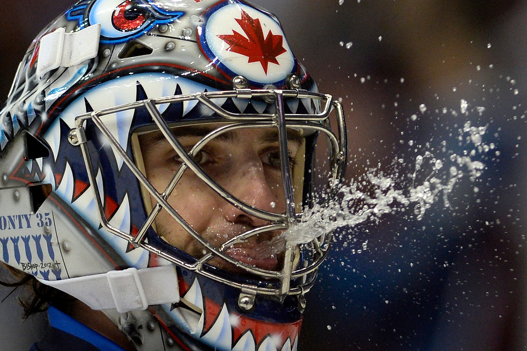 . Al Montoya (35) of the Winnipeg Jets spits water during the Colorado Avalanche\'s 3-2 win. (Photo by AAron Ontiveroz/The Denver Post)