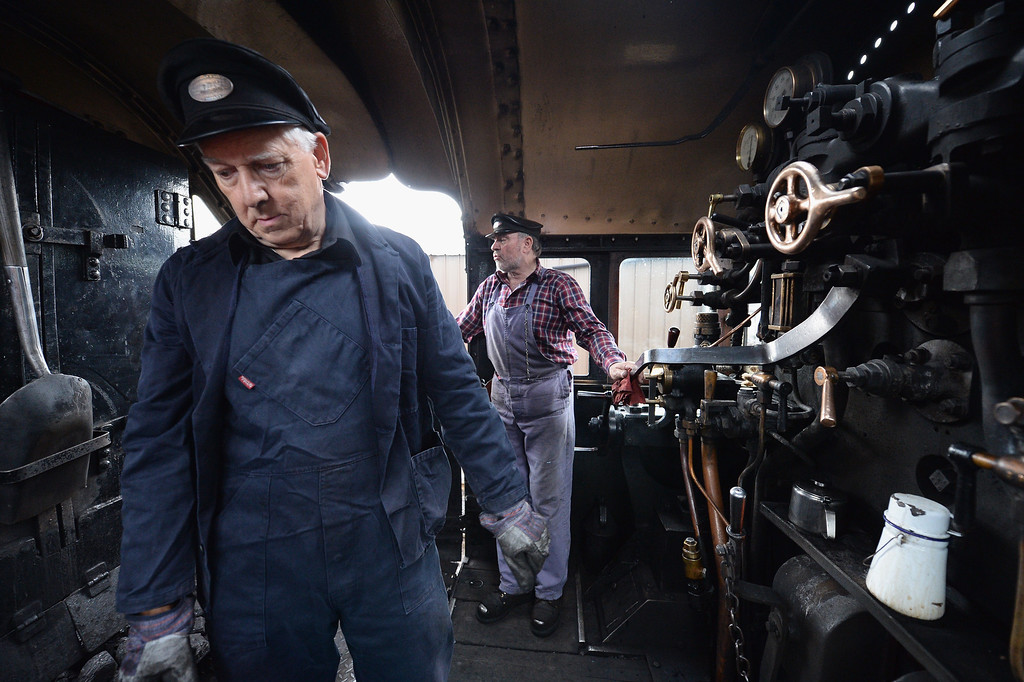 . Fireman Ken Plant and driver Henry Leese look from the plate of a 1952 British Rail Ivatt number 46512 at Strathspey Steam Railway on August 27, 2013 in Aviemore, Scotland.   (Photo by Jeff J Mitchell/Getty Images)