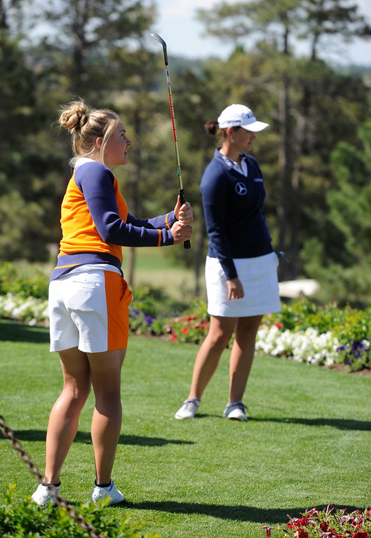 . Solheim Cup european golfers Charley Hull, left, and Caroline Masson, right, enjoy a chipping contest at the Colorado Golf Club on media day in Parker Colorado, June 02, 2013.  (Photo By Andy Cross/The Denver Post)