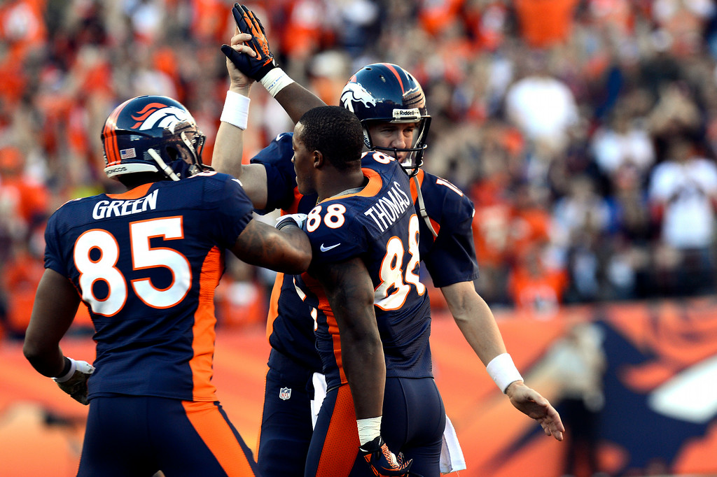 . From left, Virgil Green, Demaryius Thomas and Peyton Manning celebrate a Broncos touchdown against the San Diego Chargers at Sports Authority Field on Sunday, November 18, 2012. (Joe Amon, The Denver Post)