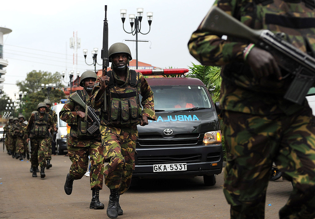 . Military personnel mobilize on September 21, 2013 outside an upmarket shopping mall in Nairobi, where suspected terrorists engaged Kenyan security forces in a drawn out gun fight. Some 20 people have been killed and about 50 wounded Saturday in the initial attack by the gunmen the Kenya Red Cross said.  AFP PHOTO / Tony  KARUMBA/AFP/Getty Images