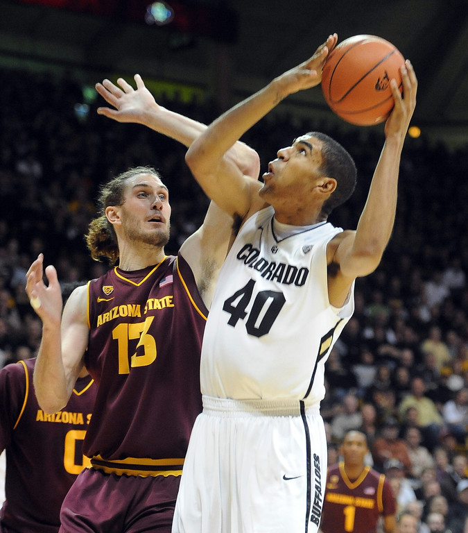 . Colorado\'s Josh Scott, right, looks to shoot over Arizona State\'s Jordan Bachynski during the first half of an NCAA college basketball game on Saturday, Feb. 16, 2013, in Boulder, Colo. (AP Photo/Daily Camera, Cliff Grassmick)
