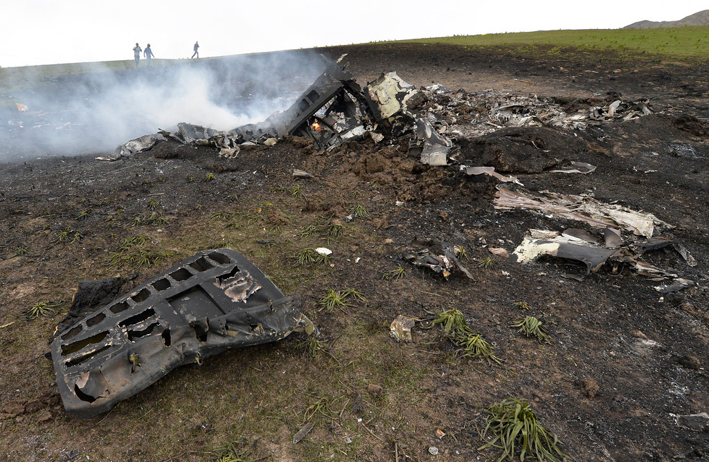 . Wreckage from a U.S. Air Force KC-135 tanker aircraft wreckage is strewn across a field near the village of Chaldovar, about 100 miles (160 kms) west of the Kyrgyz capital Bishkek, Friday, May 3, 2013. (AP Photo/Vladimir Voronin)
