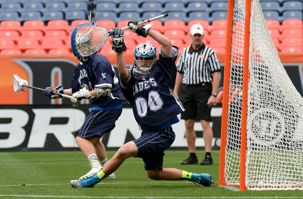 . DENVER, CO. - MAY 18 : Goalie Bennett Riefstahle of Air Academy High School (00) scored by Tyler Morpurgo of Wheat Ridge High School (25) during the 4A Boy\'s Lacrosse Championship game at Sports Authority Field at Mile High Stadium. Denver, Colorado. May 18, 2013. (Photo By Hyoung Chang/The Denver Post)