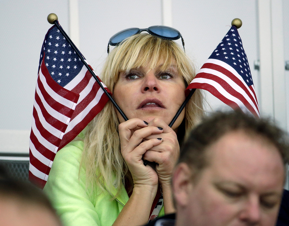. A United States fan watches the women\'s 3000-meter speedskating competition at the 2014 Winter Olympics, Sunday, Feb. 9, 2014, in Sochi, Russia. (AP Photo/Morry Gash)