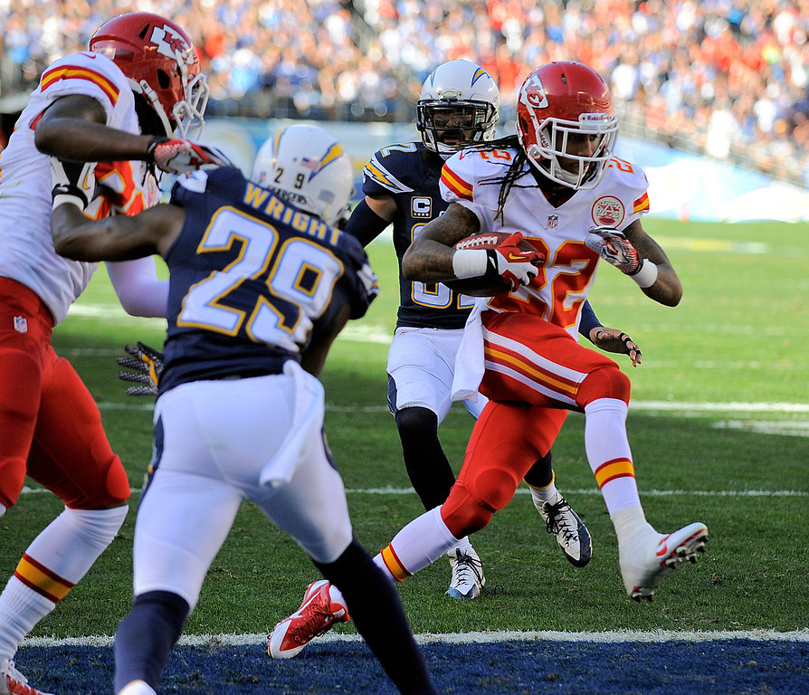 . Kansas City Chiefs wide receiver Dexter McCluster, right, scores a touchdown against the San Diego Chargers during the first half of an NFL football game, Sunday, Dec. 29, 2013, in San Diego. (AP Photo/Denis Poroy)