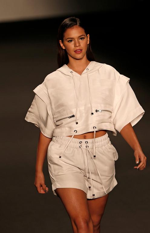 . Brazilian actress Bruna Marquezine wears a creation from the Coca Cola Jeans collection during Fashion Week in Rio de Janeiro, Brazil, Wednesday, April 9, 2014. (AP Photo/Silvia Izquierdo)