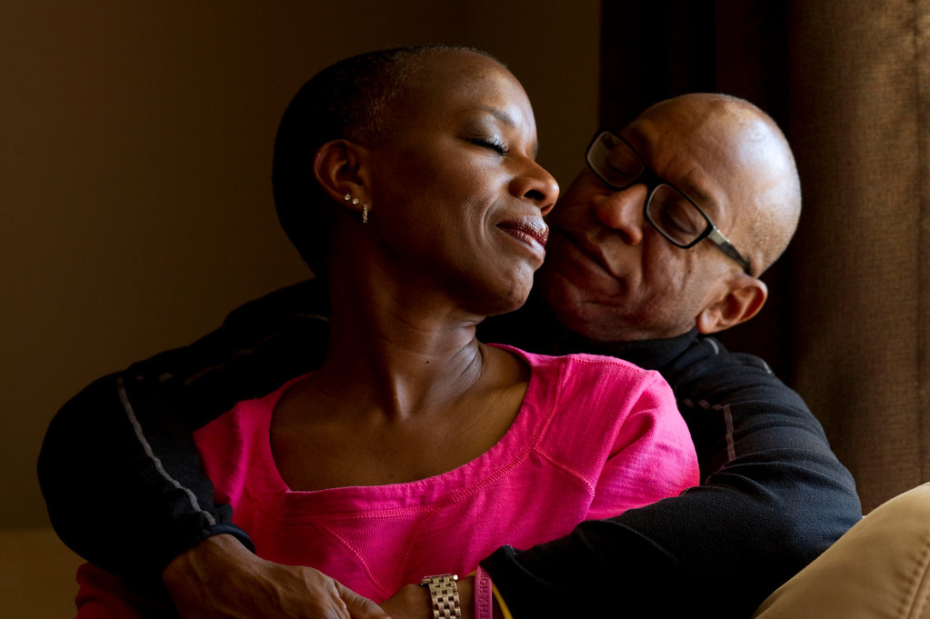 . Saundra Robinson shares a quiet moment with her husband Marcus Robinson at their home Thursday, March 22, 2012 in Denver. Saundra Robinson survived breast cancer and works in the community to educate others. John Leyba, The Denver Post