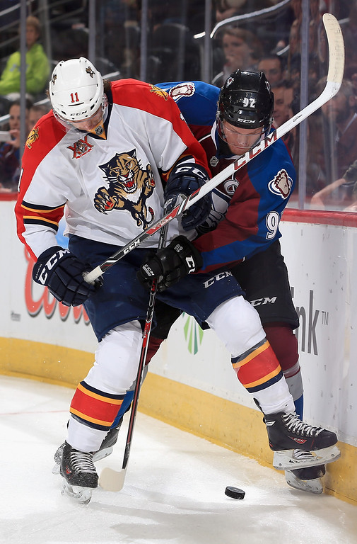 . DENVER, CO - NOVEMBER 16:  Jonathan Huberdeau #11 of the Florida Panthers and Gabriel Landeskog #92 of the Colorado Avalanche battle for control of the puck at Pepsi Center on November 16, 2013 in Denver, Colorado.  (Photo by Doug Pensinger/Getty Images)