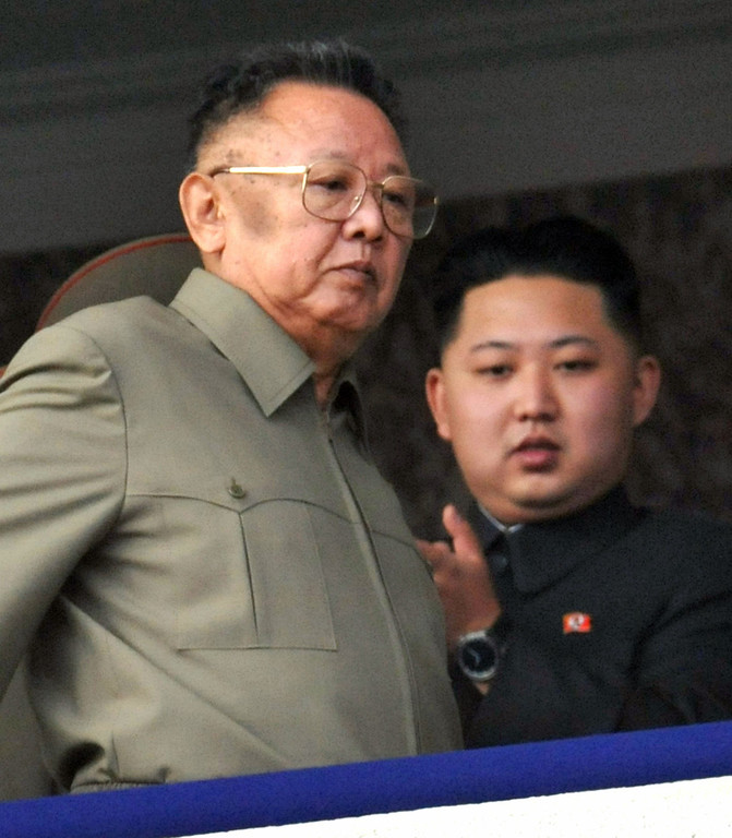 . In this Oct. 10, 2010 photo, Kim Jong Un, right, along with his father and North Korea leader Kim Jong Il, left, attends during a massive military parade marking the 65th anniversary of the ruling Workers\' Party in Pyongyang, North Korea. North Korea fired a long-range rocket Wednesday, Dec. 12, 2012 in its second launch under its new leader, South Korean officials said, defying warnings from the U.N. and Washington only days before South Korean presidential elections.  (AP Photo/Kyodo News)