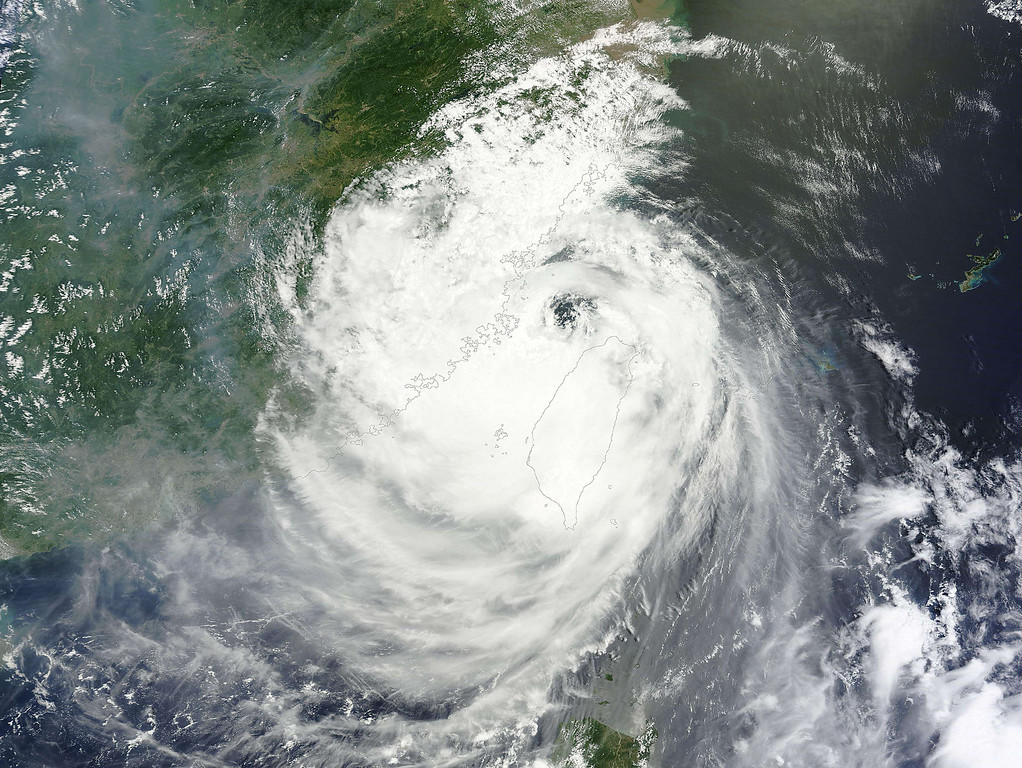 """. This NASA satellite image shows Typhoon Soulik  on July 13, 2013. Soulik made landfall on the northeast coast of Taiwan around 03:00 am July 13 (2000 GMT July 12), packing winds of up to 190 kilometres an hour (118 miles), the Central Weather Bureau (CWB) said. Soulik battered Taiwan with torrential rain and powerful winds on Saturday that left two people dead and at least 100 injured. Roofs were ripped from homes, debris and fallen trees littered the streets, and some areas were submerged by flood waters. One town in central Taiwan reported \""""widespread\"""" landslides and water levels a storey high. Around 8,000 people were evacuated from their homes before the typhoon struck, with hundreds of soldiers deployed to high-risk areas and the whole island declared an \""""alert zone\"""" by the authorities. AFP PHOTO / NASA"""