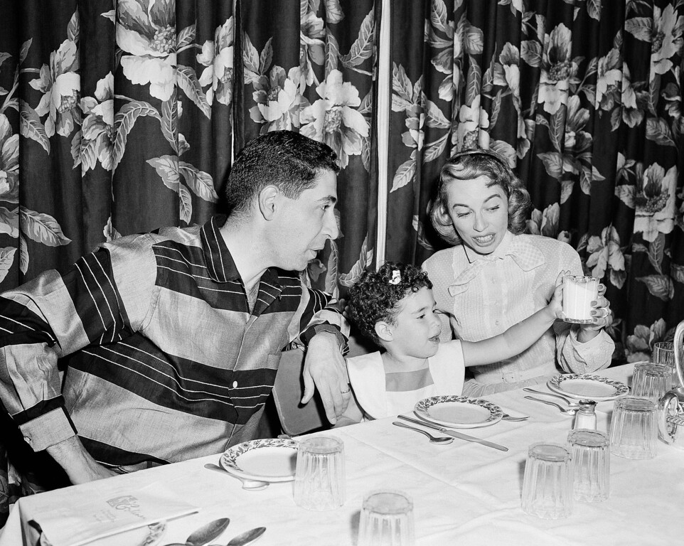 . Psychologist Dr. Joyce Brothers, right, is shown with her husband, Dr. Milton Brothers and their daughter, Lisa, 3, at the Goldman Hotel in Pleasantville, N.J. July 22, 1956, during a vacation. (AP Photo)