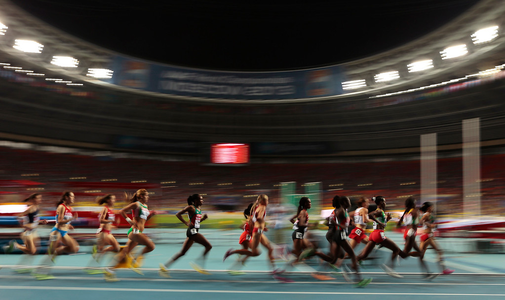 . Athletes compete in the women\'s 10000-meter final at the World Athletics Championships in the Luzhniki stadium in Moscow, Russia, Sunday, Aug. 11, 2013. (AP Photo/Ivan Sekretarev)