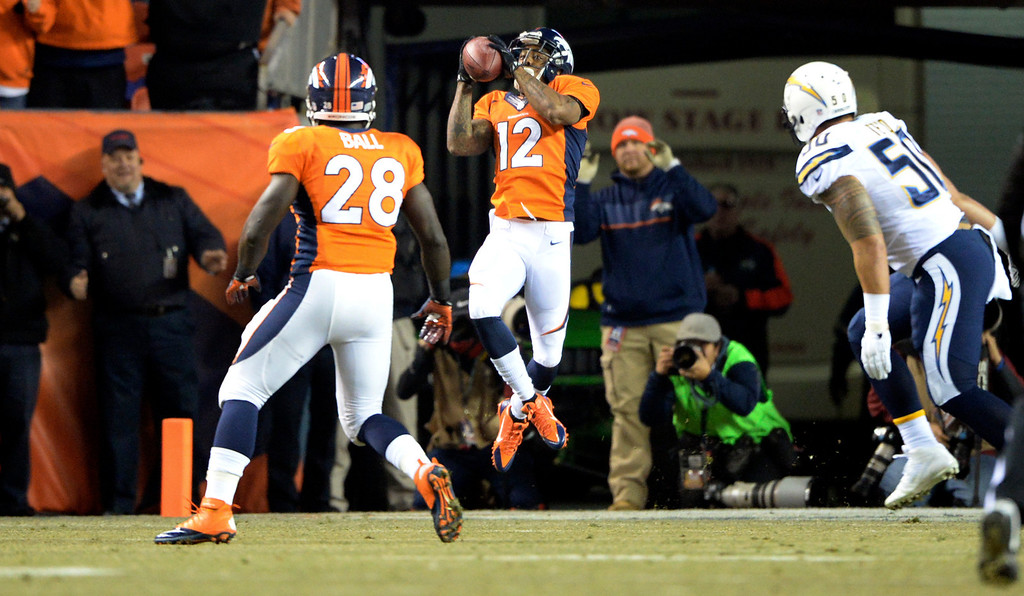 . Denver Broncos wide receiver Andre Caldwell (12) pulls in a pass from Peyton Manning scoring the first touchdown of the game in the first quarter.  The Denver Broncos vs. the San Diego Chargers at Sports Authority Field at Mile High in Denver on December 12, 2013. (Photo by Hyoung Chang/The Denver Post)