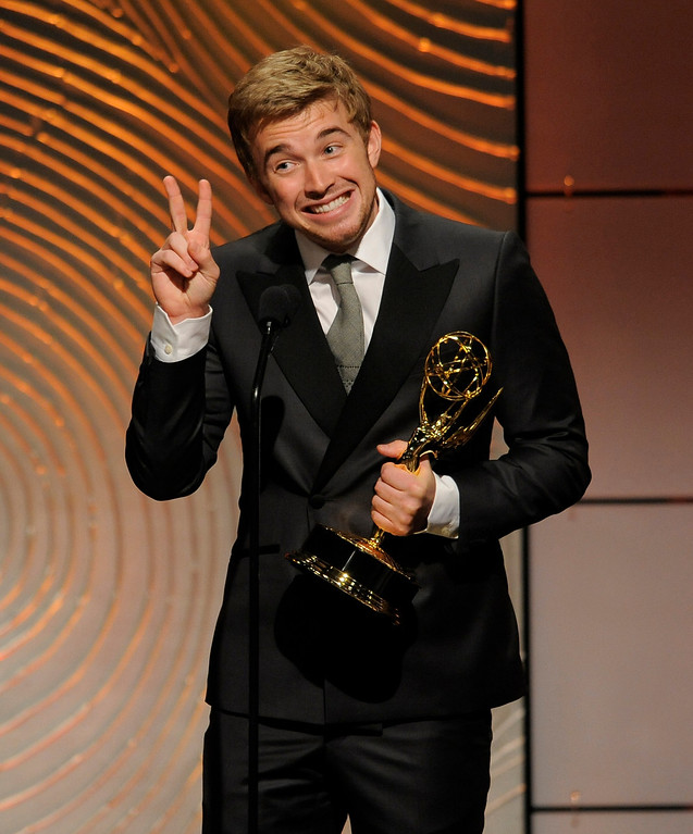 ". Chandler Massey accepts the award for outstanding younger actor in a drama series for ""Days of our Lives\"" at the 40th Annual Daytime Emmy Awards on Sunday, June 16, 2013, in Beverly Hills, Calif. (Photo by Chris Pizzello/Invision/AP)"