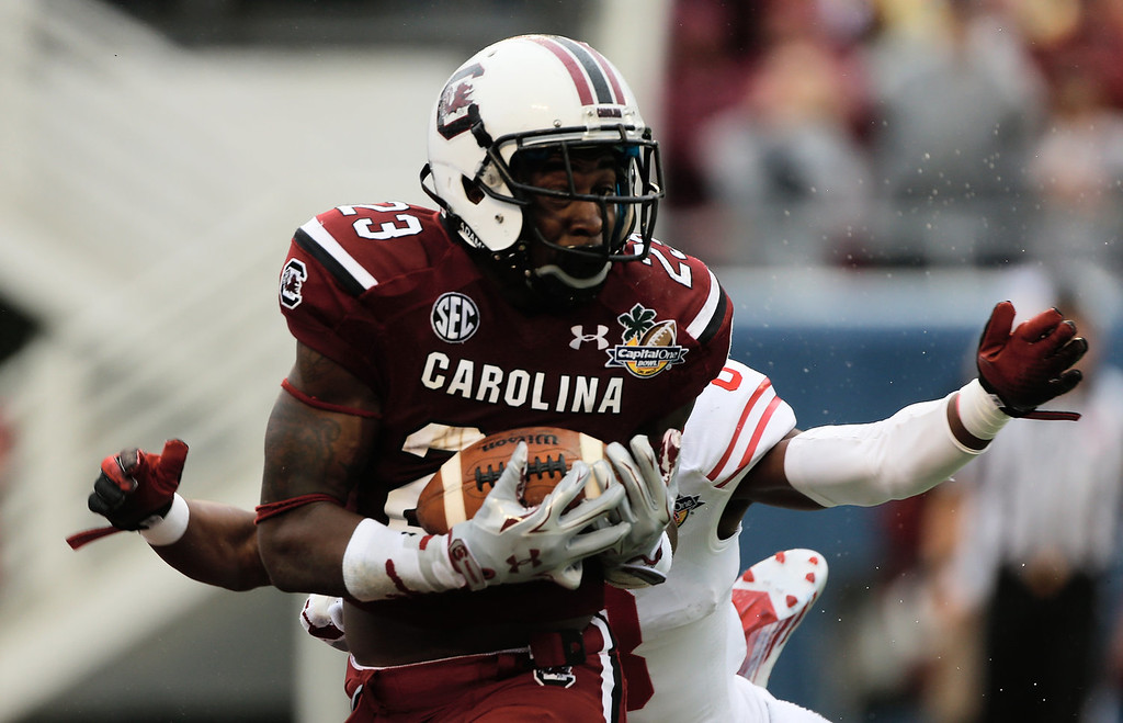 . Bruce Ellington  #23 of the South Carolina Gamecocks hauls in a 39 yard touchdown pass during the first half of their game against the Wisconsin Badgers at the Capital One Bowl on January 1, 2014 in Orlando, Florida.  (Photo by Scott Halleran/Getty Images)