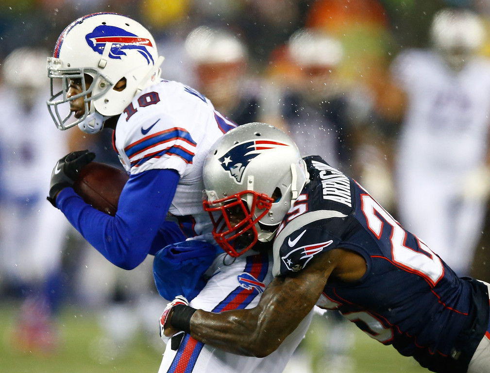 . Robert Woods #10 of the Buffalo Bills catches a pass in front of Kyle Arrington #25 of the New England Patriots in the first half during the game at Gillette Stadium on December 29, 2013 in Foxboro, Massachusetts.  (Photo by Jared Wickerham/Getty Images)