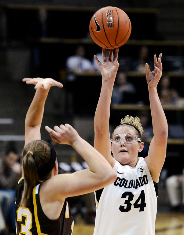. Colorado\'s Jen Reese (34) shoots over Wyoming\'s Ashley Sickles during their NCAA college basketball game, Wednesday, Nov. 28, 2012, in Boulder, Colo. (AP Photo/The Daily Camera, Jeremy Papasso)