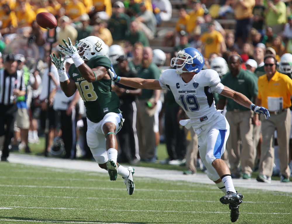 . Baylor cornerback Xavien Howard (18) intercepts a pass intended for Buffalo wide receiver Alex Neutz (19), right, in the first half of a NCAA college football game, Saturday, Sept., 7, 2013, in Waco, Texas. (AP Photo/Waco Tribune Herald, Jerry Larson)