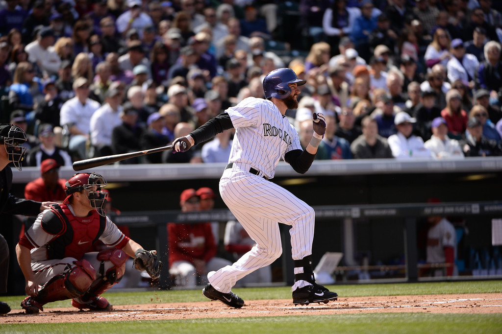 . Charlie Blackmon (19) hits a double off of Diamondbacks pitcher Randall Delgado during the first inning. The Colorado Rockies hosted the Arizona Diamondbacks in the Rockies season home opener at Coors Field in Denver, Colorado Friday, April 4, 2014. (Photo by Hyoung Chang/The Denver Post)