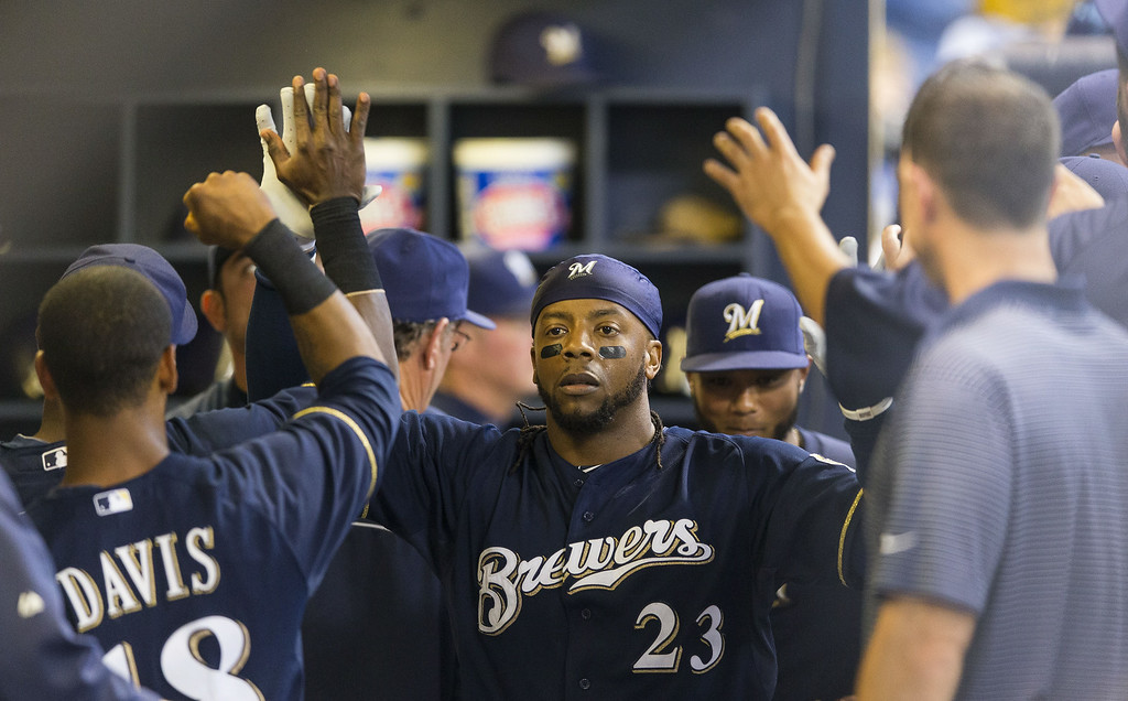 . Rickie Weeks #23 of the Milwaukee Brewers is greeted by teammates after hitting a first inning solo home run against the Colorado Rockies at Miller Park on June 26, 2014 in Milwaukee, Wisconsin.  (Photo by Tom Lynn/Getty Images)