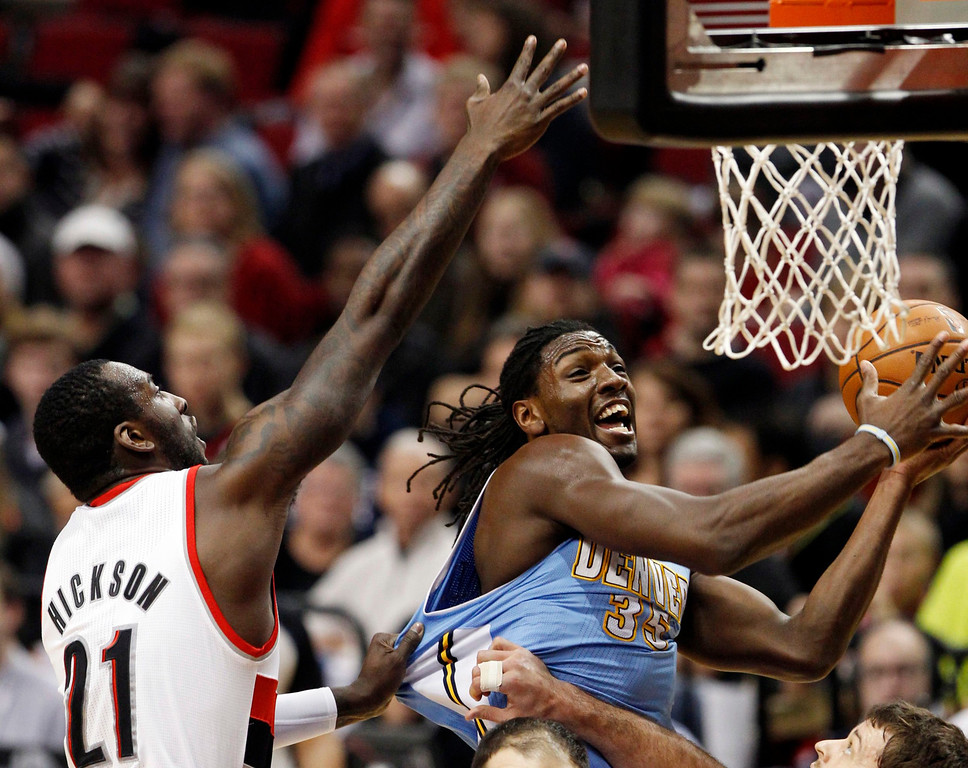 . Denver Nuggets small forward Kenneth Faried (35) shoots as Portland Trail Blazers center J.J. Hickson (21) defends during first quarter of their NBA basketball game in Portland, Oregon, December 20, 2012.  REUTERS/Steve Dipaola