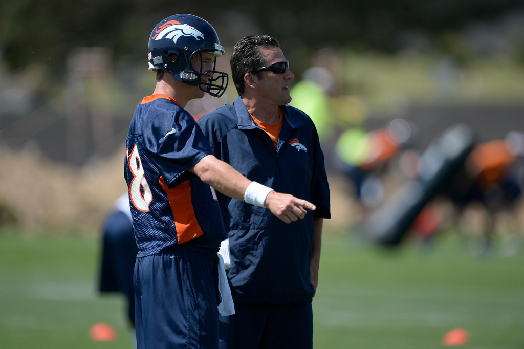 . Denver Broncos Peyton Manning (18) talks with quarterbacks coach Greg Knapp during OTAs June 10, 2014 at Dove Valley. (Photo by John Leyba/The Denver Post)