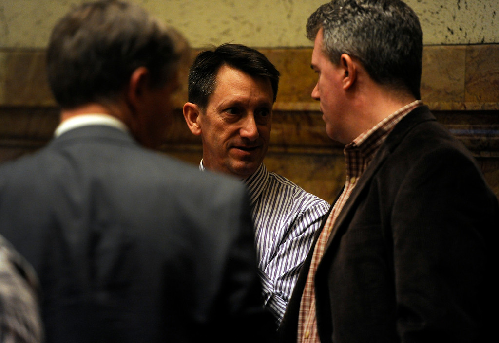 . DENVER, CO. - MARCH 8: Senator Greg Brophy, center speaks with Secretary of State Scott Gessler, right on the Senate floor. Debate begins on the Senate floor at the state capitol on various gun bills before the state legislature. (Photo By Kathryn Scott Osler/The Denver Post)