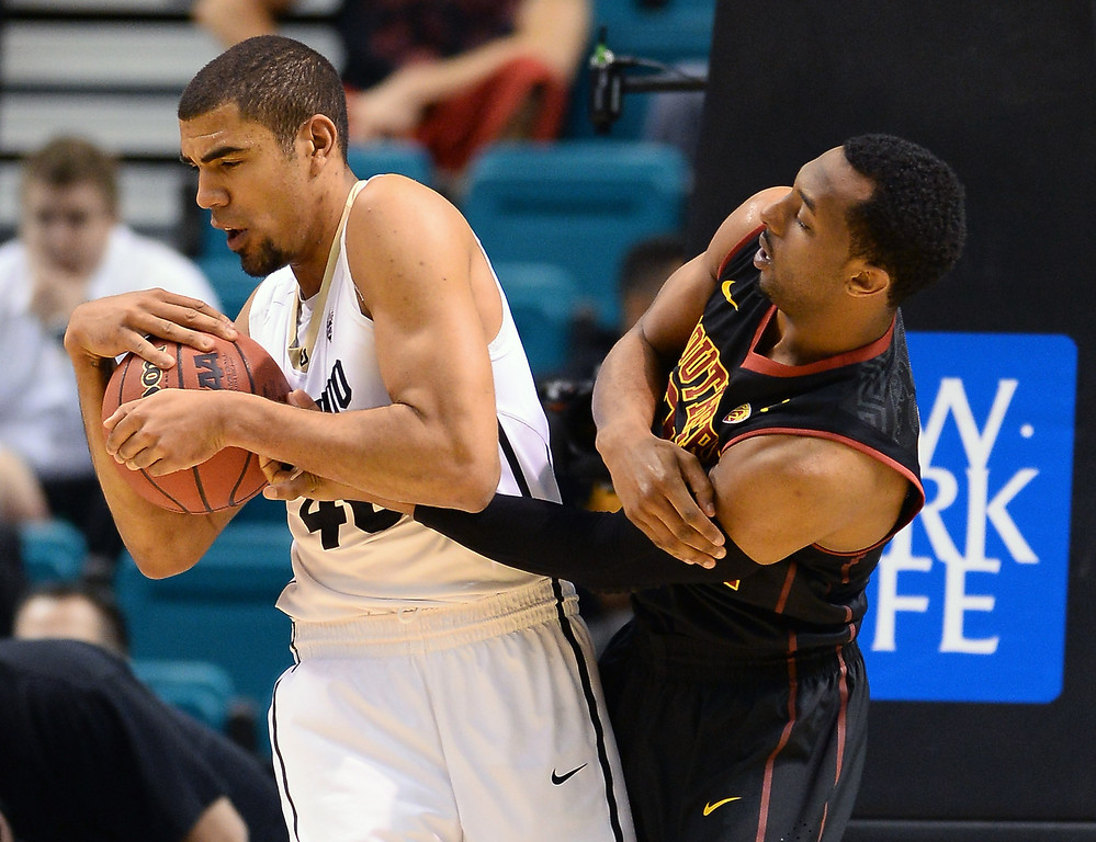. Byron Wesley #22 of the USC Trojans tries to steal the ball from Josh Scott #40 of the Colorado Buffaloes during a first-round game of the Pac-12 Basketball Tournament at the MGM Grand Garden Arena on March 12, 2014 in Las Vegas, Nevada.  (Photo by Ethan Miller/Getty Images)