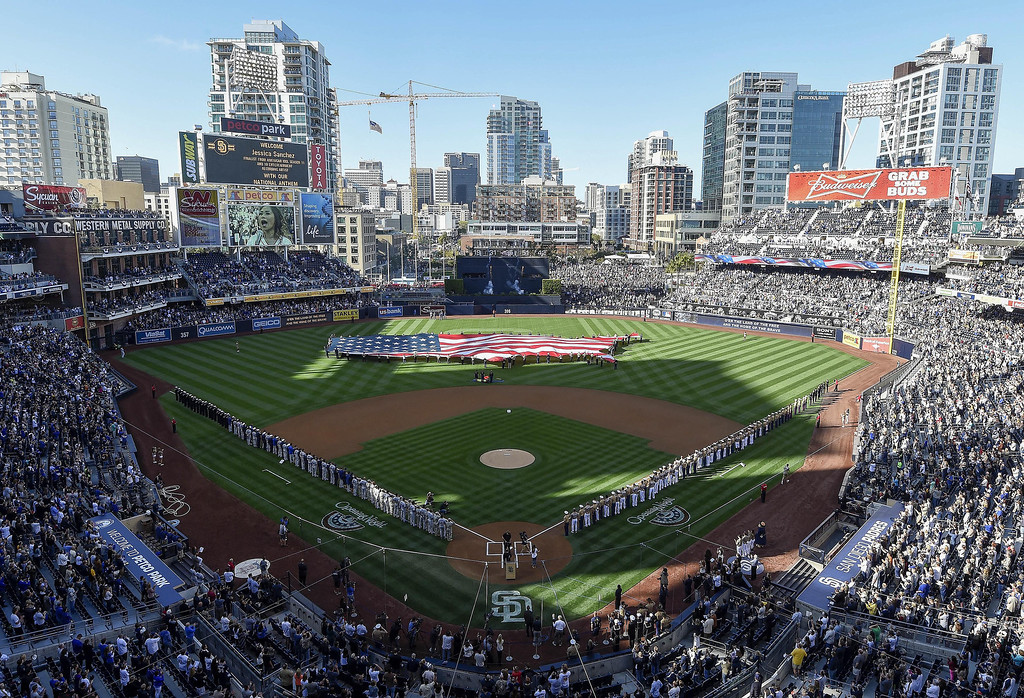 . Players line up on the field next to U.S. military members during pre-game festivities on Opening Night before a baseball game between the Los Angeles Dodgers and the San Diego Padres at Petco Park on March 30, 2014 in San Diego, California.  (Photo by Denis Poroy/Getty Images)